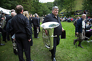The Hardraw Scaur Brass Band Festival. Shirland Welfare band walk up to the band stand for their performance. Organised by the Yorkshire and Humberside Brass Band Association, the competition is Britain's second oldest outdoor contest and takes place annually in Hardraw Scar in Wensleydale, North Yorkshire, England, UK. The area, a natural amphitheatre, attracts bands from all over the North of England and is a popular event amongst players and audiences alike.
