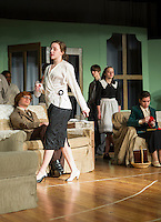 """Wanda Henrietta Blore played by Emily Paronto walks past  Phillip Lombard (John Hammond) and Emily Caroline Brent (Zina LaBrie) during Laconia High School's dress rehearsal for Agatha Christie's """"And Then There Were None...."""" Wednesday evening.  (Karen Bobotas/for the Laconia Daily Sun)"""