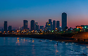 Israel, Tel Aviv beach front and skyline as seen from south, from Jaffa at dawn