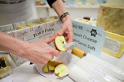 """Apples are cut to be eaten between cheese tasting during the British Cheese Awards at the Royal Bath & West show in Somerset, where more than 1,000 British cheeses are vying for the title of supreme champion at an event designed to a be a """"great celebration"""" of the industry."""