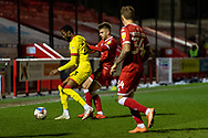 Walsall defender Zak Jules (#3) is tackled during the EFL Sky Bet League 2 match between Crawley Town and Walsall at The People's Pension Stadium, Crawley, England on 16 March 2021.