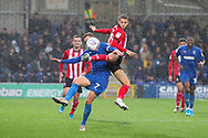 Lincoln City midfielder Jorge Grant (18) battles for possession with AFC Wimbledon midfielder Scott Wagstaff (7) during the EFL Sky Bet League 1 match between AFC Wimbledon and Lincoln City at the Cherry Red Records Stadium, Kingston, England on 2 November 2019.