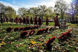 Dignitaries walk past poppy wreaths during a Remembrance Sunday service in Queen's Square, Bristol, held in tribute for members of the armed forces who have died in major conflicts.