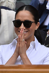 © Licensed to London News Pictures. 13/07/2019. London, UK. HRH The Duchess of Sussex watches the ladies singles finals on centre court tennis on Day 12 of the Wimbledon Tennis Championships 2019 held at the All England Lawn Tennis and Croquet Club. Photo credit: Ray Tang/LNP