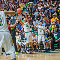 Newcomb Skyhawk Deontay Begay (15) takes a three-point shot attempt on the Tohatchi Cougars in the boys District 1-3A championship at Newcomb High School Friday.