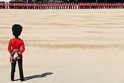 Soldiers prepare for the Trooping the Colour ceremony at Horse Guards Parade, central London, as the Queen celebrates her official birthday.