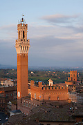 Torre del Mangia and Palazzo Pubblico — the city hall of Siena — as seen from atop the Museo dell'Opera, Tuscany, Italy.