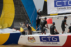 Adam Minoprio (NZL) luffs Ben Ainslie (GBR) over the line in the first race of the finals. Ben Ainslie also gets a penalty for not staying clear.  Monsoon Cup 2009. Kuala Terengganu, Malaysia. 6 December 2009. Photo: Sander van der Borch / Subzero Images