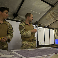 Major Matt Cansdale (center) OC of 16 Air Assualt Bde's BRF leads a planning meeting prior to an operation. FOB Jackson, Helmand Province, Afghanistan on the 13th of March 2011.