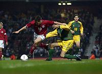 Copyright Sportsbeat. 0208 3926656<br />Picture: Henry Browne<br />Date: 12/02/2003<br />England v Australia International Friendly<br />England's Michael Owen avoids Austalia's Josip Skoko
