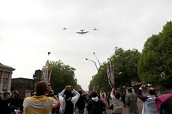 LONDON, UK  29/04/2011. The Royal Wedding of HRH Prince William to Kate Middleton. Supermarine Spitfires and a Lancaster Bomber fly down The Mall on their way towards Buckingham Palace. Photo credit should read MICHAEL GRAAE/LNP. Please see special instructions. © under license to London News Pictures