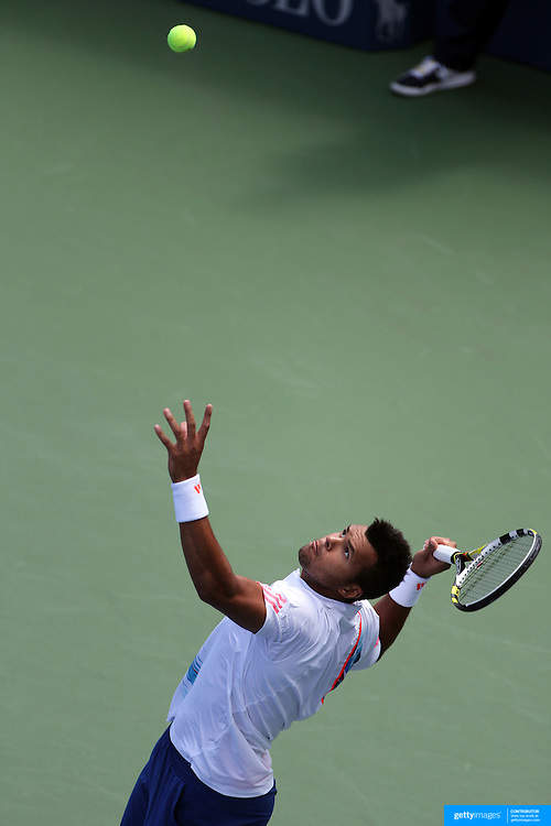 Jo-Wilfred Tsonga, France, serving against Karol Beck, Slovakia, in the Men's singles first round match during the US Open Tennis Tournament, Flushing, New York. USA. 28th August 2012. Photo Tim Clayton