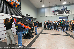 Kristi Noem, Leah Whaley, Jim Entenman and Wiley Cress unveil the 2018 Harley-Davidson Street Glide donated by the Motor Company and customized by J and L Harley-Davidson to commemorate the christening of the USS South Dakota submarine. J and L Harley-Davidson, Sioux Falls, SD. USA. Monday October 9, 2017. Photography ©2017 Michael Lichter.