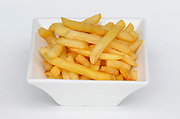 A bowl of French Fries (chips) on white background
