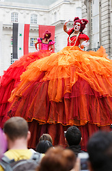 © Licensed to London News Pictures. 02/09/2012. London, England. Pictured: Transe Express, opera singers in oversized ball gowns. Piccadilly Circus Circus with performers just for one day, in celebration of the London 2012 Games. Central London around Piccadilly Circus has been transformed into a Circus arena with acrobats and performers. Part of the London 2012 Festival. Photo credit: Bettina Strenske/LNP