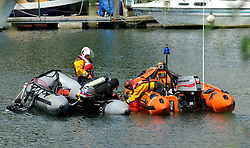 © licensed to London News Pictures. RICHMOND, UK.  01/08/11. Police diver and members of the RNLI recover a body from The Thames. The Metropolitan police search the River Thames near Richmond, London, today (1 Aug 2011) after a 17 year boy went missing after taking part in a kayak competition.  Mandatory Credit Stephen Simpson/LNP