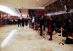 Journalists located behind the rope line on the right and tourists on the left wait to see personalities coming in and out the elevator, in the lobby of the Trump Tower, while President elect Donald Trump is holding meetings on top floors of the building, November 21, 2016, in New York, NY. (Aude Guerrucci / Pool)
