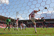 Doncaster Rovers midfileder Benjamin Whiteman (8) stops shot at goal by Portsmouth FC midfielder Gareth Evans (26) during the EFL Sky Bet League 1 match between Doncaster Rovers and Portsmouth at the Keepmoat Stadium, Doncaster, England on 25 August 2018.Photo by Ian Lyall.