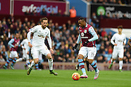 Jordan Ayew of Aston Villa goes past Gylfi Sigurdsson of Swansea city. . Barclays Premier league match, Aston Villa v Swansea city at Villa Park in Birmingham, the Midlands on Saturday 24th October 2015.<br /> pic by  Andrew Orchard, Andrew Orchard sports photography.
