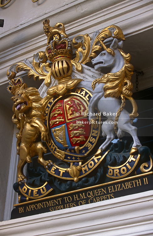 A royal warrant crest located at the entrance of a business in the wealthy Mayfair district of the capital, on 16th March 1997, in London, England. Royal warrants indicate that a shop or supplies the royal household with goods and services - a highly sought-after position guaranteeing quality for a business around the country.