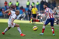 Atletico de Madrid´s Arda Turan (R) and Deportivo de la Coruña´s Laure during 2014-15 La Liga match between Atletico de Madrid and Deportivo de la Coruña at Vicente Calderon stadium in Madrid, Spain. November 30, 2014. (ALTERPHOTOS/Victor Blanco)