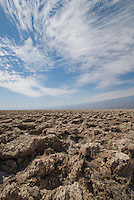 Clouds over the Devil's Golf Course, an area of wind- and rain-sculpted salt and mud  in Death Valley National Park, California.