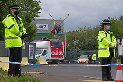 © Licensed to London News Pictures. 22/05/2021. London, UK. Police guard a scene after members of the environmental group Animal Rebellion, blocked McDonald's distribution centre in Hampstead Industrial Estate in north London. Photo credit: Marcin Nowak/LNP