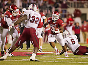 Nov 5, 2011; Fayetteville, AR, USA;  Arkansas Razorback running back Dennis Johnson (33) gets past South Carolina Gamecock defensive end Melvin Ingram (6) during a game at Donald W. Reynolds Stadium.  Mandatory Credit: Beth Hall-US PRESSWIRE