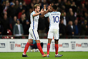 England forward Harry Kane celebrates with team mate England forward Marcus Rashford after scoring a goal (1-0) during the FIFA World Cup Qualifier match between England and Slovenia at Wembley Stadium, London, England on 5 October 2017. Photo by Martin Cole.