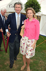 MR & MRS ARNAUD BAMBERGER at the 2004 Cartier International polo day at Guards Polo Club, Windsor Great Park, Berkshire on 25th July 2004.