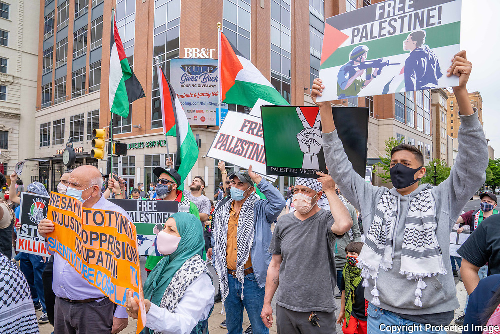 Protesters make their voices known during a Palestine solidarity rally at the war memorial in downtown Allentown, Pennsylvania.