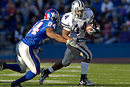 Kansas State at running back Leon Patton (14) rushes up field against pressure form Kansas safety Darrell Stuckey (24) in the first half Memorial Stadium in Lawrence, Kansas, November 18, 2006.  Kansas beat K-State 39-20.<br />