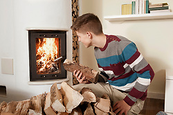 Teenage boy in front of fireside