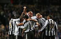 Photo: Andrew Unwin.<br /> Newcastle United v Reading. The Barclays Premiership. 06/12/2006.<br /> Newcastle's Antoine Sibierski (C) is mobbed by his team-mates after scoring their first goal.