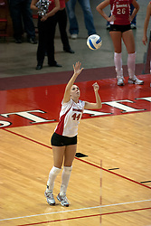 09 OCT 2005 Redbirds Ashley Grubb takes a turn at the serving line. The Illinois State University Redbirds hosted arch rival Bradley University Braves.  The Redbirds soared over the Braves, taking the match in 4 games, losing only game number 2.  Action included play by Braves Star Lindsey Stalzer who is ranked no. 7 in the nation in kills per game.  The first defeat of the conference season for the Braves took place at Redbird Arena on Illinois State's campus in Normal IL.