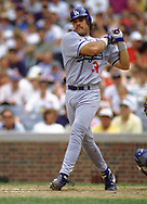 CHICAGO - 1995:  Mike Piazza of the Los Angeles Dodgers bats during an MLB game versus the Chicago Cubs at Wrigley Field in Chicago, Illinois during the 1995 season. (Photo by Ron Vesely) Subject:   Mike Piazza; Ramon Martinez