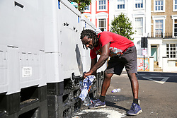 © Licensed to London News Pictures. 26/08/2019. London, UK. A man refills a bottle of drinking water from a water tank on a very hot day in London. Over a million people attends the 2019 Notting Hill Carnival, Europe's largest street party and a celebration of Caribbean traditions and the capital's cultural diversity. Photo credit: Dinendra Haria/LNP