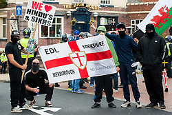 "Rotherham England<br /> 13 September 2014 <br /> Local EDL supporters from Mexbrough in Yorkshire outside Rotherham Town Hall before the start of the English Defence Leagues Justice for the Rotherham 1400 March on Saturday Afternoon described by an EDL Facebook Page as ""a protest against the Pakistani Muslim grooming gangs"" on Saturday Afternoon <br /> <br /> <br /> Image © Paul David Drabble <br /> www.pauldaviddrabble.co.uk"