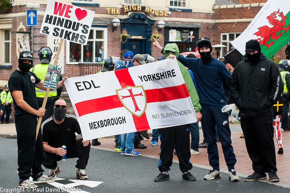 """Rotherham England<br /> 13 September 2014 <br /> Local EDL supporters from Mexbrough in Yorkshire outside Rotherham Town Hall before the start of the English Defence Leagues Justice for the Rotherham 1400 March on Saturday Afternoon described by an EDL Facebook Page as """"a protest against the Pakistani Muslim grooming gangs"""" on Saturday Afternoon <br /> <br /> <br /> Image © Paul David Drabble <br /> www.pauldaviddrabble.co.uk"""