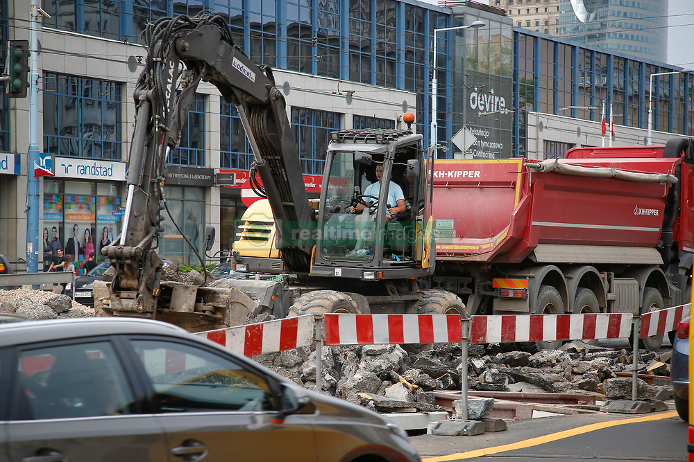 August 4, 2017 - Warsaw, Poland - An excavator is seen diggin through rubble on a main road in Warsaw, Poland on 4 August, 2017. (Credit Image: © Jaap Arriens/NurPhoto via ZUMA Press)