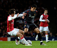 Photo: Ed Godden.<br /> Arsenal v CSKA Moscow. UEFA Champions League, Group G. 01/11/2006. Tomas Rosicky (L), slides in on CSKA Moscow's Dudu.