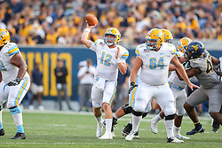 Sep 11, 2021; Morgantown, West Virginia, USA; Long Island Sharks quarterback Camden Orth (12) throws a pass during the second quarter against the West Virginia Mountaineers at Mountaineer Field at Milan Puskar Stadium. Mandatory Credit: Ben Queen-USA TODAY Sports