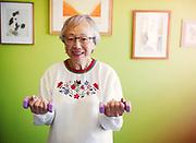 Senior asian Woman Exercising With Dumbbells