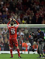 "Photo: Paul Thomas.<br /> Liverpool v PSV Eindhoven. UEFA Champions League. Quarter Final, 2nd Leg. 11/04/2007.<br /> <br /> Goal scorer Peter Crouch of Liverpool thanks the ""Kop"" end of Anfield after the game."