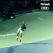 Roger Federer serves in the Barclays mens tennis championships in Dubai.<br /> <br /> Slowing down the shot gives a sense of his first serve clocked at 194 kmh.