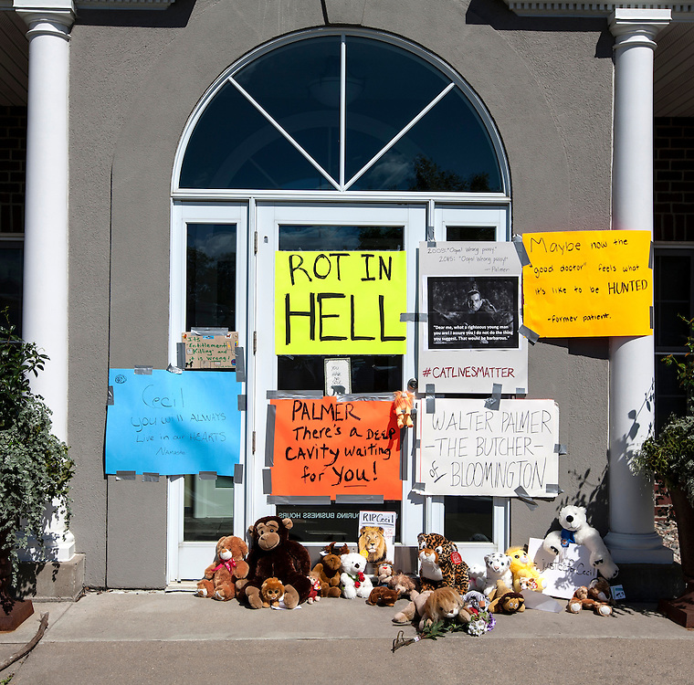 Signs cover the doors of the dental office of Walter James Palmer in Bloomington, MN, July 29, 2015.