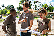 Nasir Bakari, Joe Radcliffe and Kitty Busz  preparing for the VSO ICS Community Action Day CAD held for local members of the community in Y2K Hall Lindi, Lindi region. Tanzania.