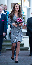 © London News Pictures. 19/02/2013. London, UK.  Catherine Duchess of Cambridge carrying flowers as she leaves Hope House addiction centre for women in South London on February 19, 2013. The Duchess met clients and staff at Hope House, which is a 23-bed residential treatment centre for women with substance dependance. The Action Photo credit: Ben Cawthra/LNP