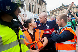 "Rotherham England<br /> 13 September 2014 <br /> EDL stewards and police marshal the English Defence Leagues ""Justice for the Rotherham 1400"" March on Saturday Afternoon described by an EDL Facebook Page as ""a protest against the Pakistani Muslim grooming gangs"" on Saturday Afternoon <br /> <br /> <br /> Image © Paul David Drabble <br /> www.pauldaviddrabble.co.uk"