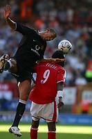 Photo: Jo Caird<br />Charlton v Manchester United at The Valley.<br />13/09/2003.<br />Rio Ferdinando climbs on Jason Euell